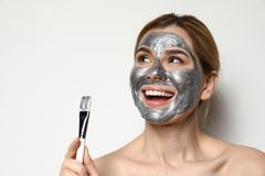 Beautiful woman applying mask onto face royalty free stock image