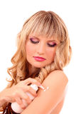 Beautiful woman applying moisturizer Royalty Free Stock Photo