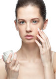 Beautiful woman applying moisturizer cream Royalty Free Stock Photos