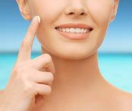 Beautiful woman applying moisturizing cream Royalty Free Stock Photo