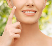 Beautiful woman applying moisturizing cream Stock Image