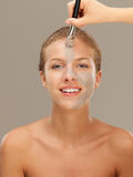 Beautiful woman applying mud mask with brush Royalty Free Stock Images