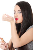 Beautiful woman applying perfume Stock Photos
