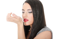 Beautiful woman applying perfume Royalty Free Stock Photography