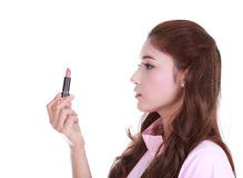 Beautiful woman applying pink lipstick Stock Photography