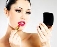 Free Beautiful Woman Applying Pink Lipstick On Lips Royalty Free Stock Image - 30108206