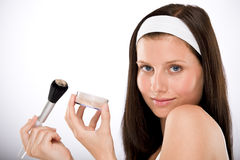 Beautiful woman applying powder with brush Royalty Free Stock Photography