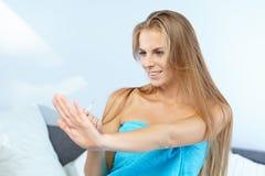 Beautiful woman applying red nail polish Stock Images