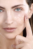 Beautiful woman applying scrub treatment on face Royalty Free Stock Photos