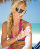 Beautiful woman applying sunscreen Stock Image
