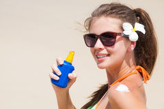 Beautiful woman applying suntan cream Royalty Free Stock Photography