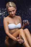 Beautiful woman applying therapeutic mud in spa Stock Photography