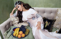 Beautiful woman arabic fruit dress silk fashion harem Royalty Free Stock Image