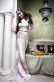 Beautiful woman arabic fruit dress silk fashion harem Stock Photo