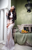 Beautiful woman arabic fruit dress silk fashion harem Stock Photography