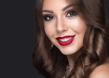 Beautiful woman with arabic make-up, red lips and Royalty Free Stock Photo