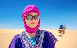 Beautiful woman in arabic traditional clothing against Sahara de royalty free stock photo