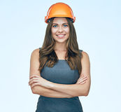 Beautiful woman architect, engineer standing against white backg. Round. Studio isolated Stock Photo