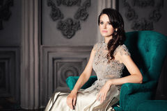 Beautiful Woman in a Armchair Royalty Free Stock Images