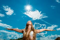 beautiful woman with arms outstretched against the background Stock Image