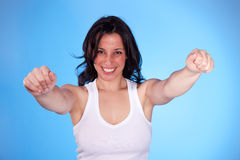 Beautiful  woman with arms raised as victory signa Stock Image
