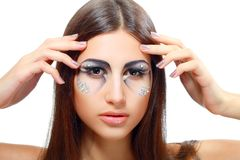 Beautiful woman with art make up Stock Photo