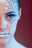 Beautiful woman with art make up and rhinestone Stock Image