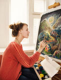 Beautiful woman artist drawing her picture Royalty Free Stock Photo