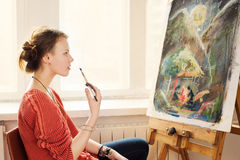 Beautiful woman artist drawing her picture Royalty Free Stock Photography