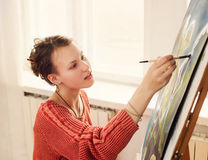 Beautiful woman artist drawing her picture Stock Photography