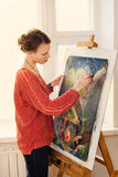 Beautiful woman artist drawing her picture Stock Image