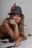 Beautiful woman artist in fedora Stock Photography