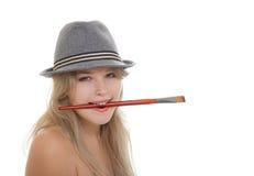 Beautiful woman artist in fedora Stock Image