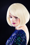 Beautiful Woman with Artistic Glitters Makeup and Blonde Hair Royalty Free Stock Image