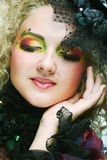 Beautiful woman with artistic make-up. Stock Photography