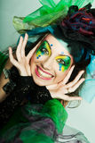 Beautiful woman with artistic make-up. Royalty Free Stock Images