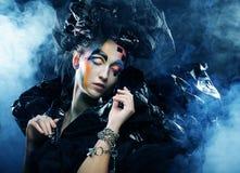 Beautiful woman with artistic make-up Stock Photo