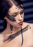 Beautiful woman with artistic unusual makeup Stock Image