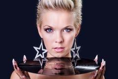 Beautiful woman as dj Stock Photography