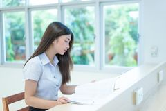 Beautiful women asian university student in library. Beautiful woman asian university student in library stock images