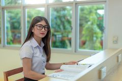 Beautiful women asian university student in library. Beautiful woman asian university student in library royalty free stock photography