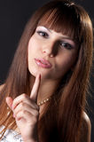 Beautiful woman asks silence. Stock Photo