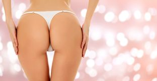 Beautiful woman ass on an abstract background Royalty Free Stock Photography