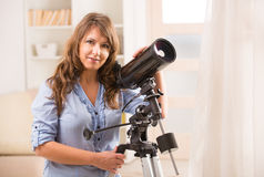 Beautiful woman with astronomical telescope Stock Photography