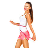 Beautiful woman with an athletic figure royalty free stock photography