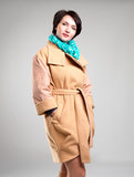 Beautiful woman in autumn coat with green scarf Stock Image
