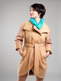 Beautiful woman in autumn coat with green scarf Royalty Free Stock Photography