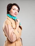 Beautiful woman in autumn coat with green scarf Royalty Free Stock Image