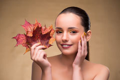 The beautiful woman in with autumn dry leaves. Beautiful woman in with autumn dry leaves royalty free stock photography