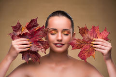 The beautiful woman in with autumn dry leaves. Beautiful woman in with autumn dry leaves stock photos